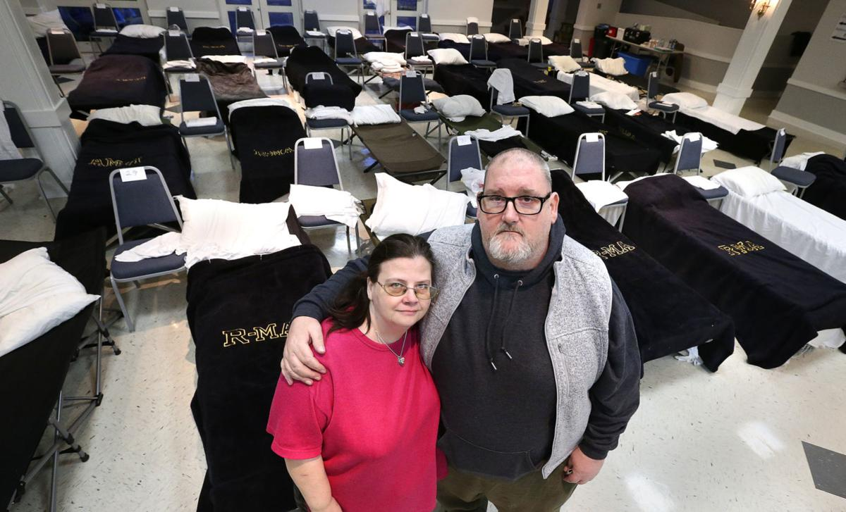 Wayne Daniels and his girlfriend, Cherie Donivan, donated $1,000 to the Winchester Area Temporary Thermal Shelter (WATTS) on Wednesday night at Christ Episcopal Church in Winchester. They were homeless for a few months and WATTS helped them get back on their feet. Photo by Jeff Taylor/The Winchester Star